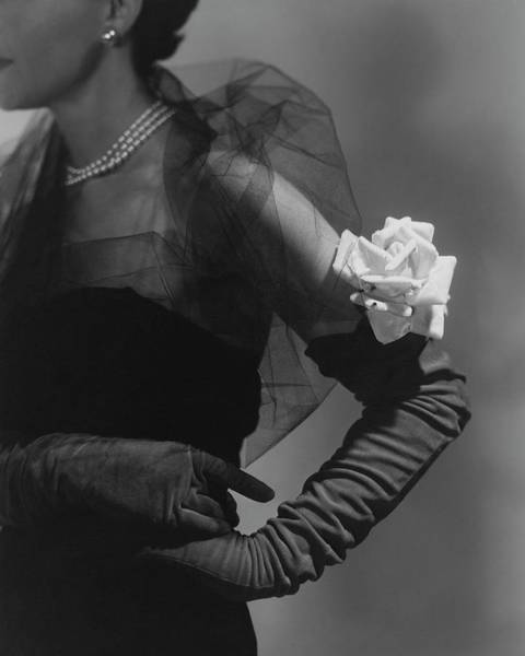 Jewelry Photograph - A Model Wearing And Velvet Rose by Horst P. Horst