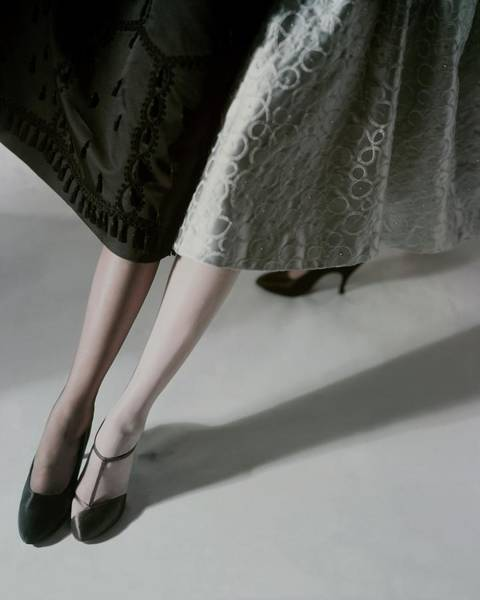 Black Background Photograph - A Model Wearing Artcraft Stockings by Horst P. Horst