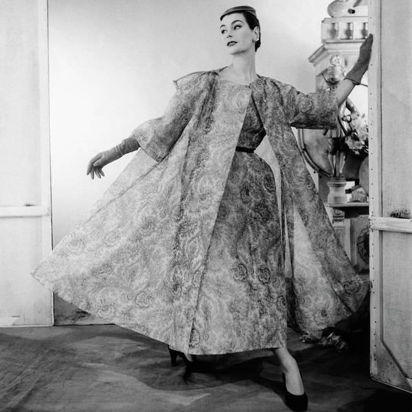 Wall Art - Photograph - A Model Wearing Balenciaga by Henry Clarke