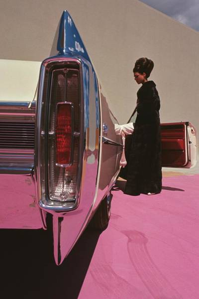 Autos Photograph - A Model Wearing Emeric Partos Entering A 1965 by Gene Laurents