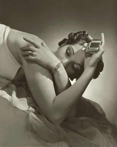 Lying Down Photograph - A Model Wearing Tiffany And Co Jewelry by Horst P. Horst