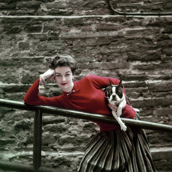 Wall Photograph - A Model With A Dog Leaning On A Railing by Richard Rutledge