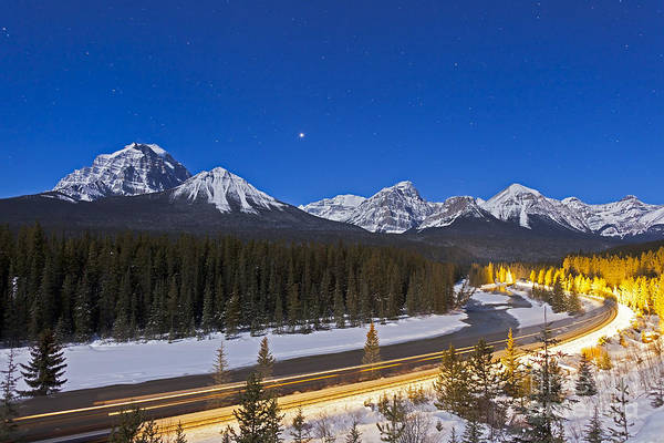 Canadian National Railway Photograph - A Moonlit Nightscape Over The Bow River by Alan Dyer