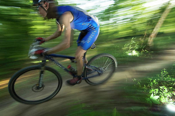 Conyers Photograph - A Mountain Biker Races On A Trail by Andrew Kornylak