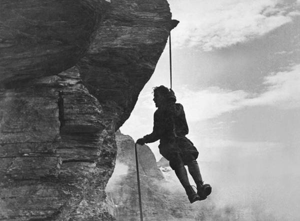 Single Person Wall Art - Photograph - A Mountain Climber Rappelling by Underwood Archives