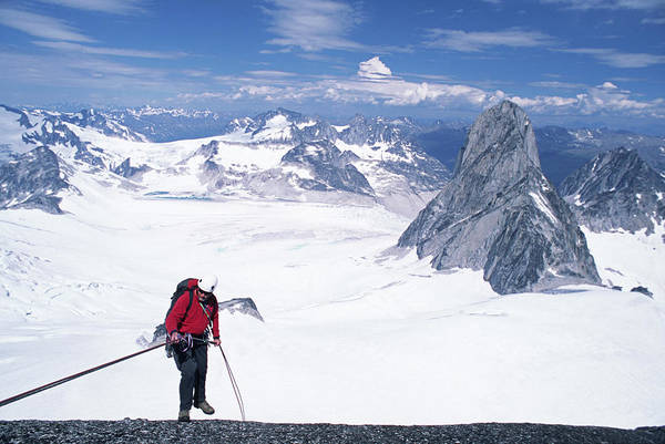 Bugaboo Photograph - A Mountain Climber Rappels Off A Peak by Cliff Leight