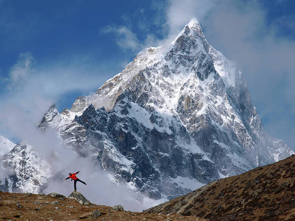 Wall Art - Photograph - A Mountaineer Balancing On A Rock by Menno Boermans
