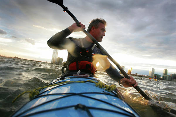 Unusual Perspective Wall Art - Photograph - A Nab Sea Kayaks Around Manhattan, New by Olivier Renck