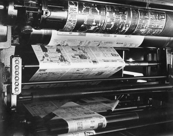 Printing Photograph - A Newspaper Being Printed by Underwood Archives