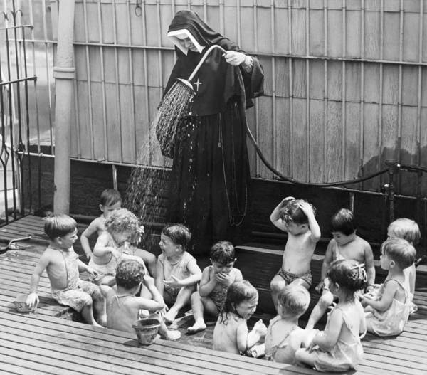 Kindergarten Photograph - A Nun Watering Children by Underwood Archives