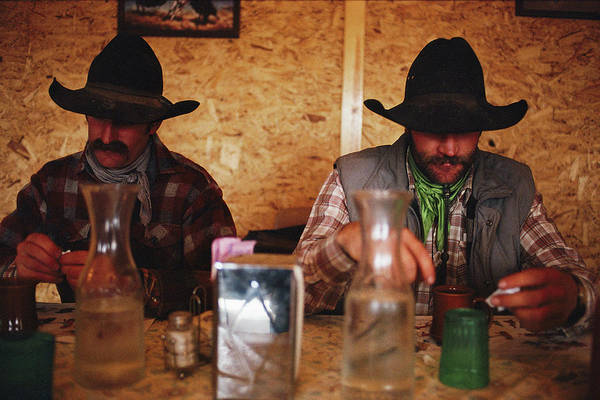 Wall Art - Photograph - A Pair Of Cowboys Enjoy A Cup Of Coffee by Joel Sartore