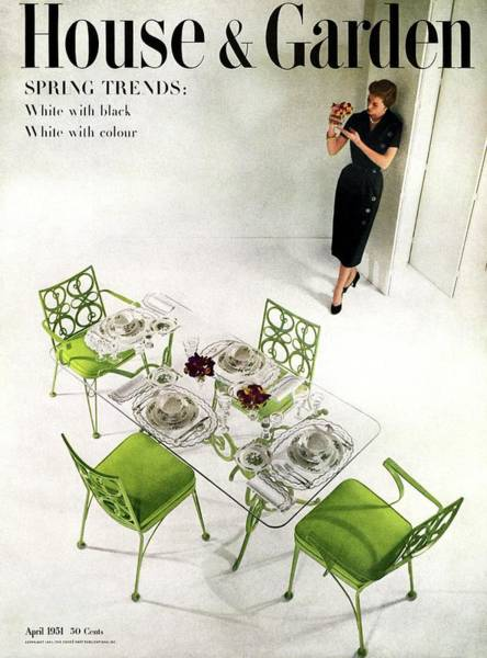 Dine Photograph - A Patio Table With A Model Standing Behind by Herbert Matter