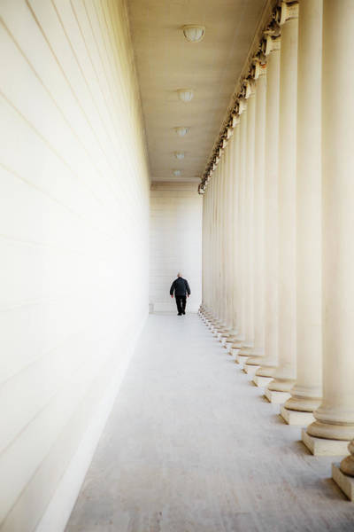 Legion Of Honor Photograph - A Person Among Columns by Ron Koeberer