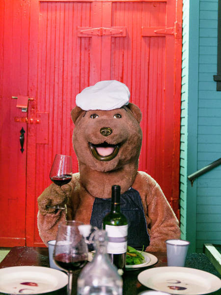 Door To Door Photograph - A Person In Bear Costume Holds A Drink by Robert Benson