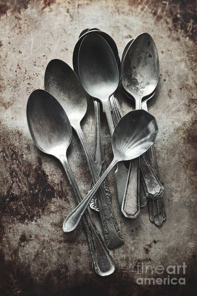 Photograph - A Pile Of Old Silver Spoons On Grungy Background by Sandra Cunningham