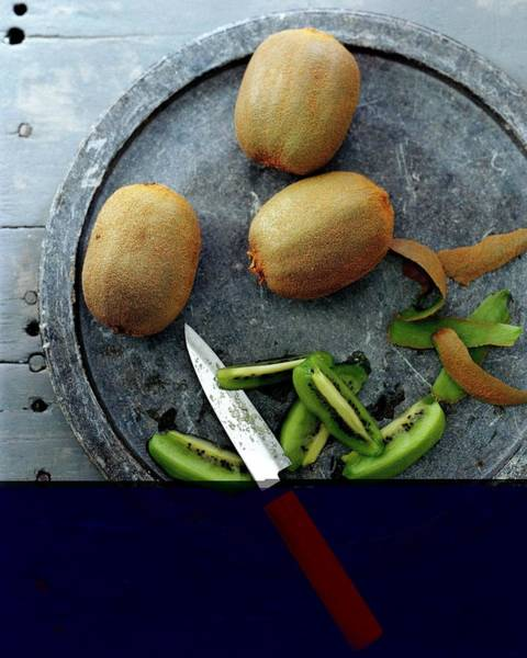 Plate Photograph - A Plate Of Kiwifuit by Romulo Yanes