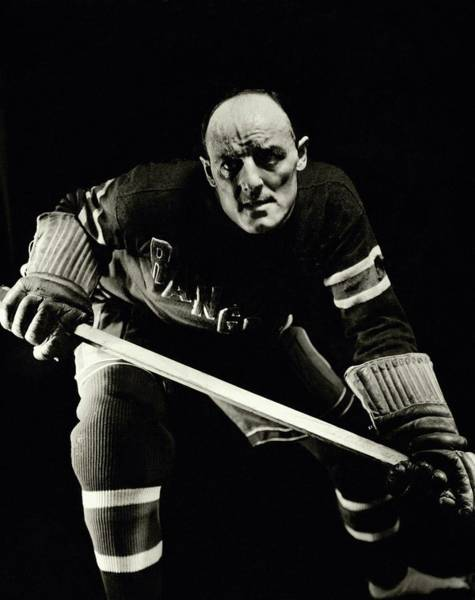 Sports Uniform Photograph - A Portrait Of Ching Johnson Posing In An Ice by Anton Bruehl