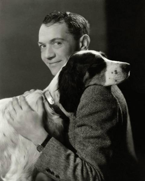 Pet Portrait Photograph - A Portrait Of John Held Jr. Hugging A Dog by Nickolas Muray
