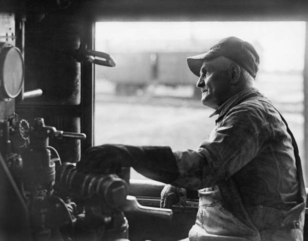 Sunny Side Up Wall Art - Photograph - A Railroad Engineer At Work by Underwood Archives