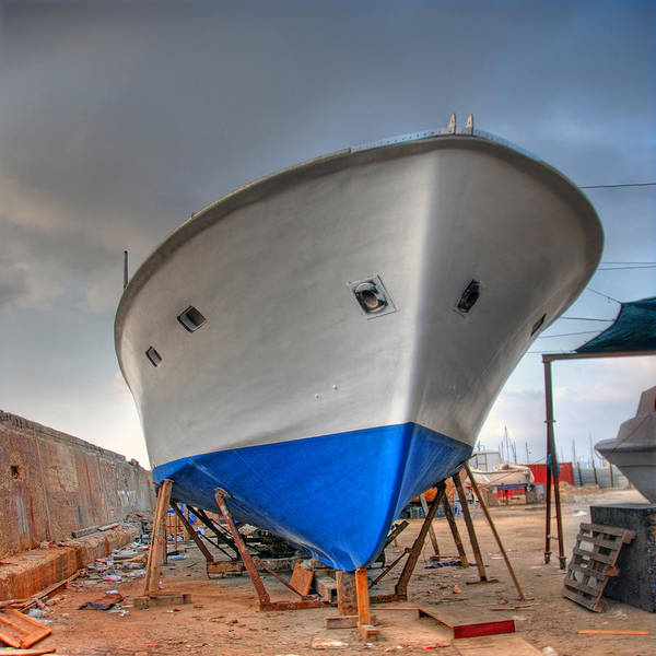 Wall Art - Photograph - a resting boat in Jaffa port by Ron Shoshani