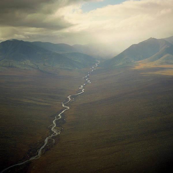 Wall Art - Photograph - A River Flows Through The Tundra In Far by Kari Medig