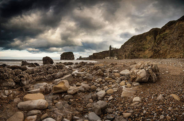 Waters Edge Photograph - A Rocky Beach Along The Waters Edge by John Short / Design Pics