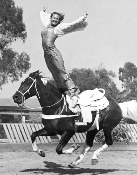 Stunt Photograph - A Roman Stand On Horseback by Underwood Archives