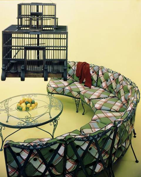 Outdoor Furniture Photograph - A Round Couch And A Birdcage by Haanel Cassidy