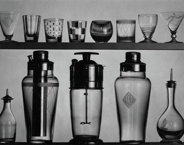 Cocktail Shaker Photograph - A Row Of Glasses On A Shelf by The 3