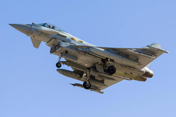 Flying The Flag Wall Art - Photograph - A Royal Air Force Typhoon Fighter by Rob Edgcumbe