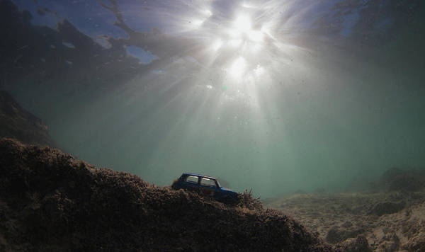 Underwater Scene Photograph - A Rusty Toy Car Perched On A Reef by Rainer Schimpf