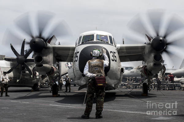 Uss George Washington Wall Art - Photograph - A Sailor Directs A C-2a Greyhound by Stocktrek Images