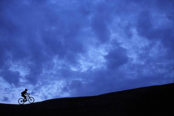 It Professional Photograph - A Silhouette Of A Woman Mountain Biking by Corey Rich