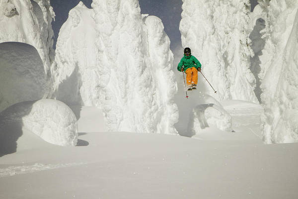 Wall Art - Photograph - A Skier Bursts Through Snowy Trees by Noah Couser