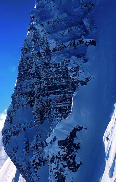 Jackson Hole Photograph - A Skier Drops From Snowy Cliff by Lucas Gilman