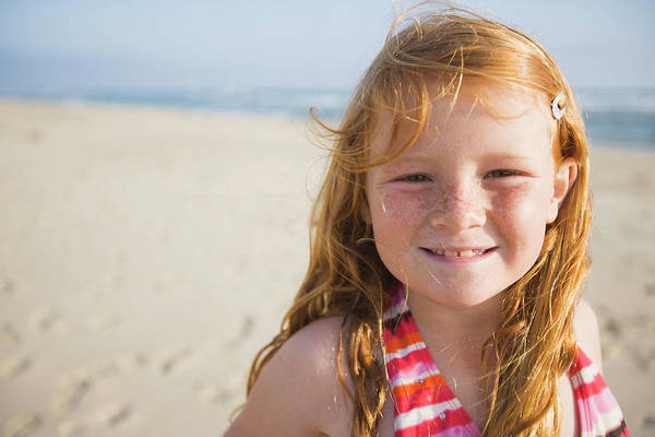 Exuberance Photograph - A Smiling Young Girl Enjoys A Sunny by Ty Milford