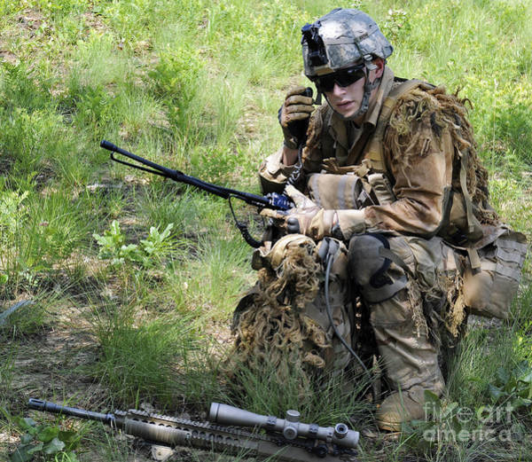 Fort Bragg Wall Art - Photograph - A Sniper Conducts A Radio Check by Stocktrek Images