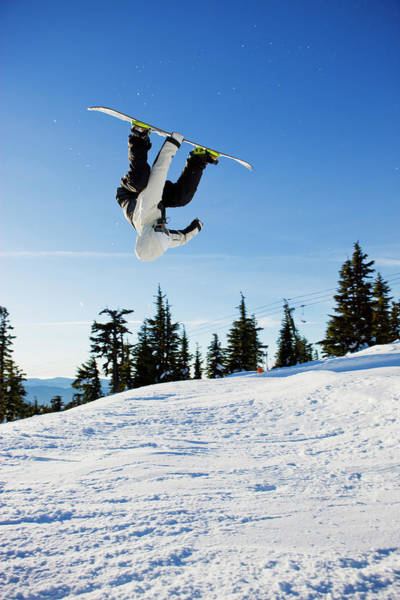 Timberline Photograph - A Snowboarder Does A High Flying Ariel by Ty Milford