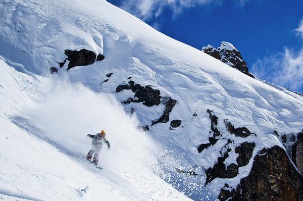 Knit Hat Photograph - A Snowboarder Slashes Powder Snow by Ben Girardi