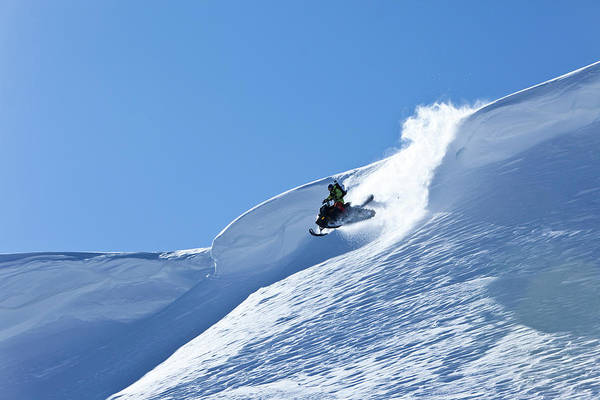 Wall Art - Photograph - A Snowmobiler Jumping Off A Cornice by Patrick Orton