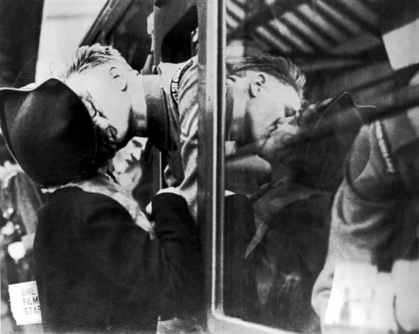 Wall Art - Photograph - A Soldier's Double Kiss by Underwood Archives