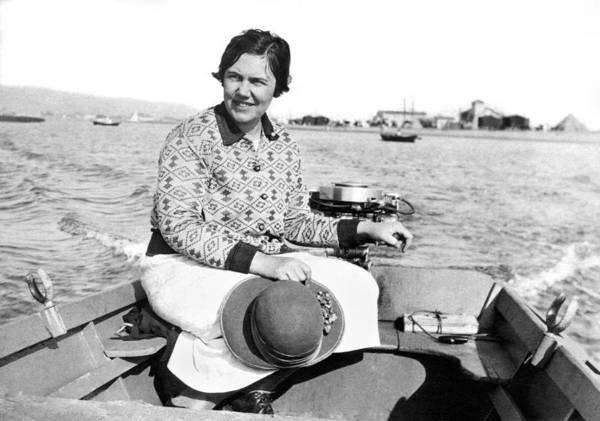 Outboard Photograph - A Solo Woman In A Motor Boat by Underwood Archives