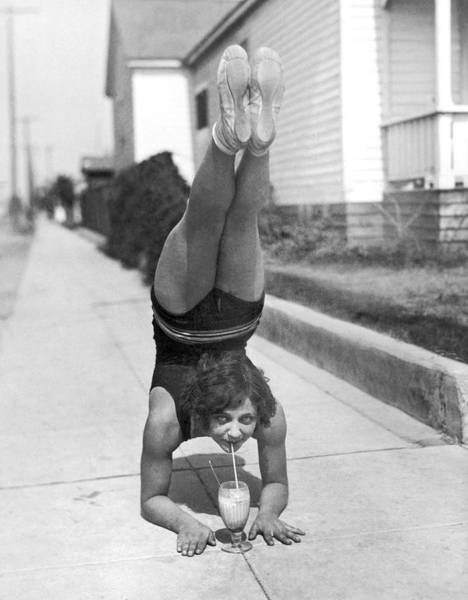Soda Straws Photograph - California Girl Imbibes Soda Upside Down by Underwood Archives