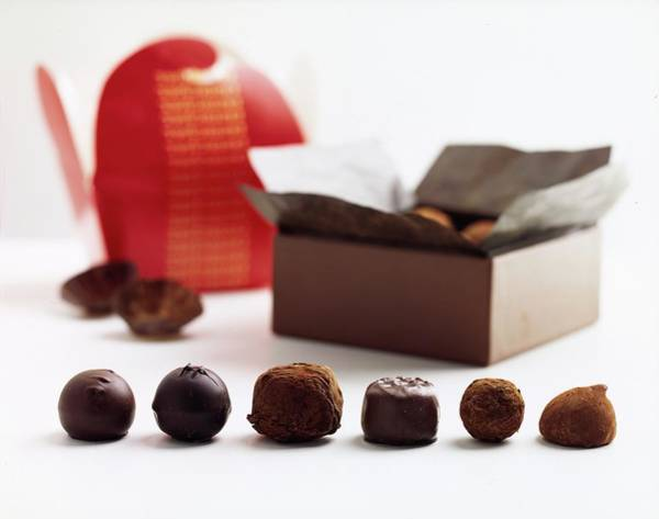 Sweet Photograph - A Still Life Photo Of Gourmet Chocolates by Romulo Yanes