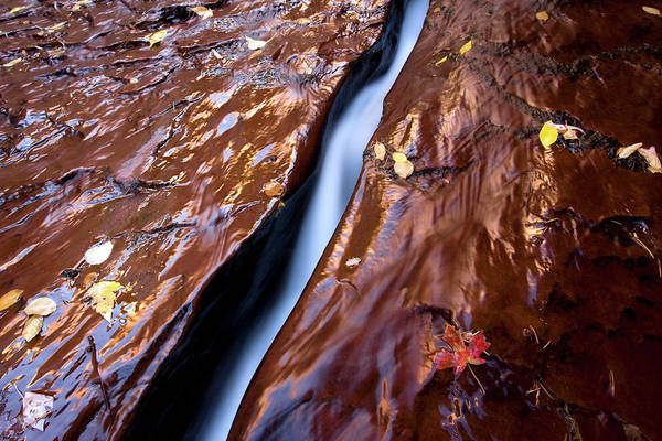 Wall Art - Photograph - A Stream Of Water Cuts A Slot by David Stubbs