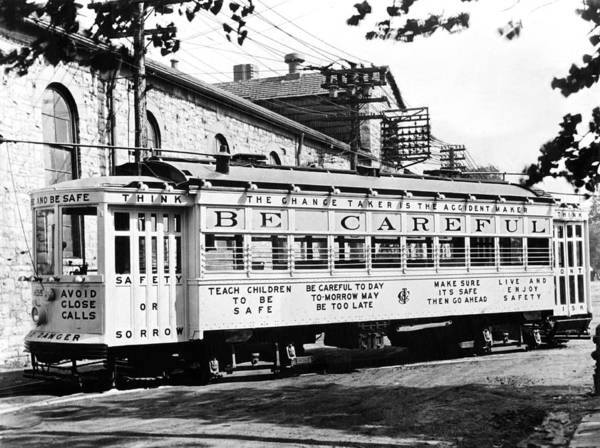 Trolley Car Wall Art - Photograph - A Streetcar Named Safety First by Underwood Archives