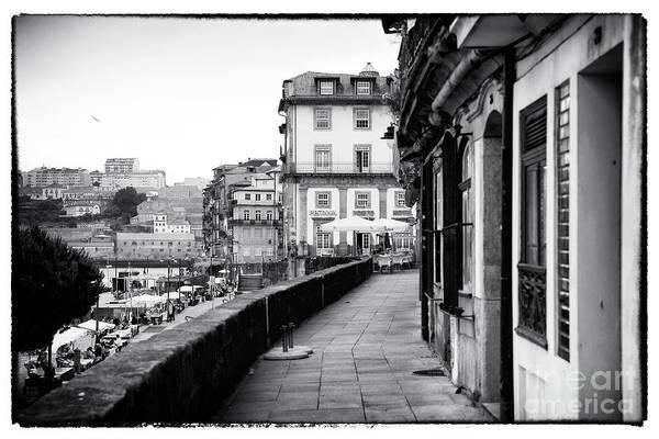 Photograph - A Stroll In Porto by John Rizzuto