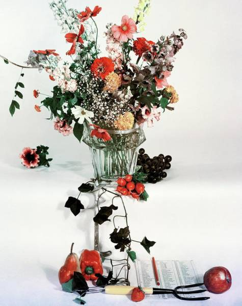 Fruits Photograph - A Studio Shot Of A Vase Of Flowers And A Garden by Herbert Matter