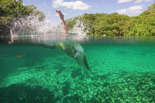 Quintana Roo Photograph - A Swimmer Diving Into The Water by Marcos Ferro