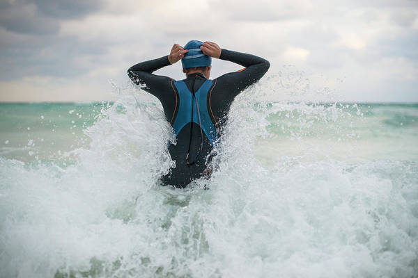 Wetsuit Wall Art - Photograph - A Swimmer Getting Into The Ocean by Marcos Ferro